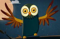 Une image de hibou avec des grands yeux jaunes et les ailes écartées