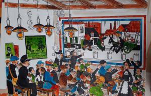 Une image issue des collections du patrimoine de la Médiathèque qui représente un spectacle de marionnettes avec beaucoup de monde dans le public.
