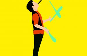 Illustration représentant un dessin de circassien en train de jongler avec 3 quille et un ballon en équilibre sur une page tenue sur sa bouche.