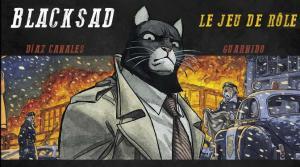 """Photo de la boite du jeu de rôle Blacksad : le chat, personnage principal de la bande dessinée blacksad est au centre d'un paysage de feu. Inscription """"Blacksad, le jeu de rôle. Diaz, Canales, Guarnido"""" (ces derniers sont les auteurs de la BD)"""